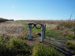 A huge pair of Buddy Holly-style glasses along a smal road is the only indication that you've reached the crash site where musicians Buddy Holly, Ritchie Valens and The Big Bopper died on February 3, 1959. Image: Nancy Atkinson