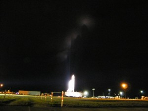 The shuttle stack silhouetted in shadow against the clouds during a midnight rollout on March 2, 2010. Image: Nancy Atkinson