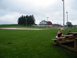 Box seats down the third base line at the Field of Dreams.